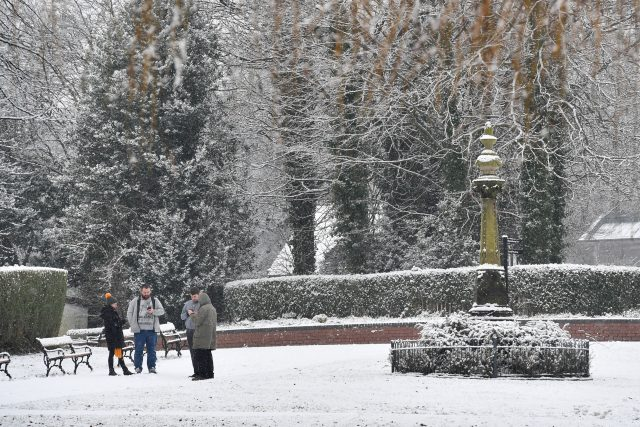 People in snow covered Stamford Park in Ashton-Under-Lyne, Greater Manchester. (Anthony Devlin/PA)