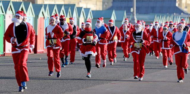 Competitors take part in the annual Santa Dash along the promenade in Brighton. (Gareth Fuller/PA)