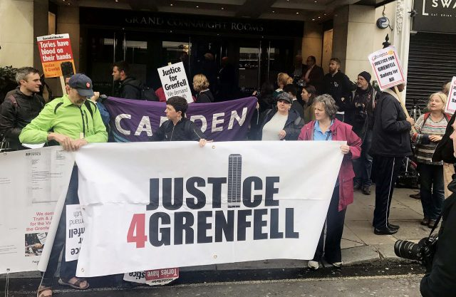 Protesters outside the Grenfell Tower public inquiry (Jack Hardy/PA)