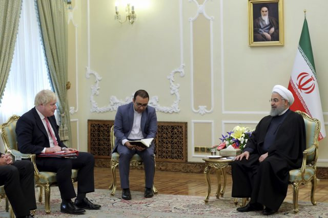 Iranian President Hassan Rouhani, right, meets Boris Johnson (Iranian Presidency Office via AP)