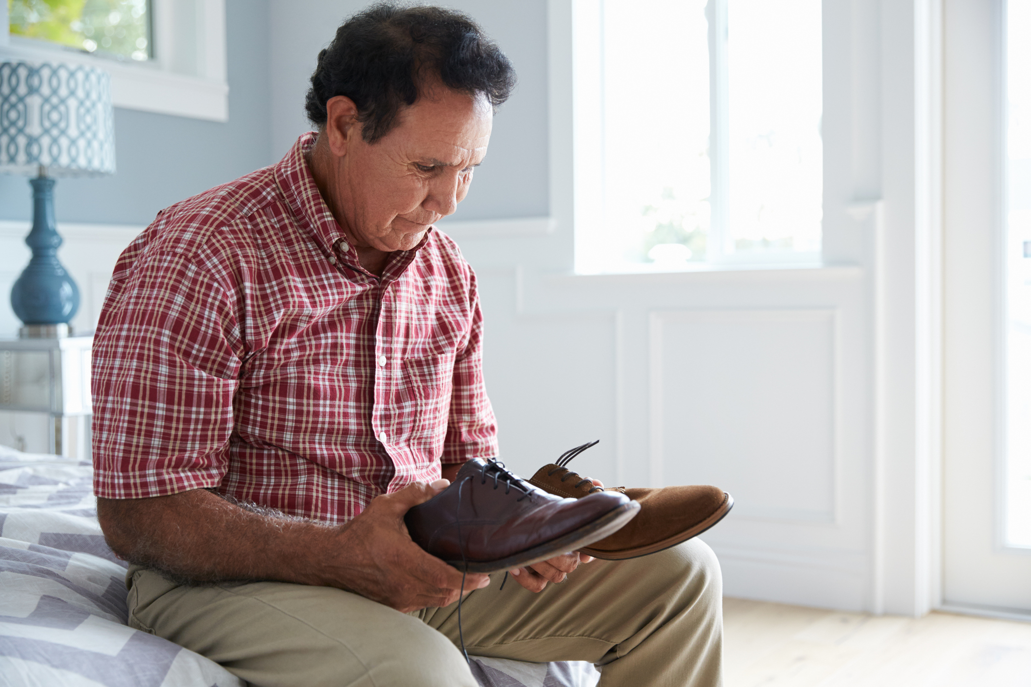 Generic photo of man with dementia looking at pair of shoes (Thinkstock/PA)