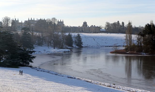 The stately home also had thick ice visible in its pond  (Steve Parsons/PA)