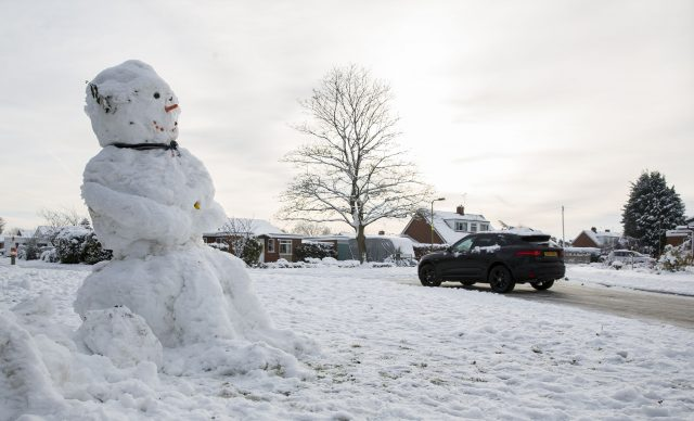 One of the advantages of the coldest night in Shawbury was it preserved this snowman (Peter Byrne/PA)