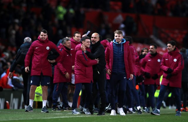Pep Guardiola (centre) and his Manchester City team celebrated at the final whistle (Mike Egerton/EMPICS)