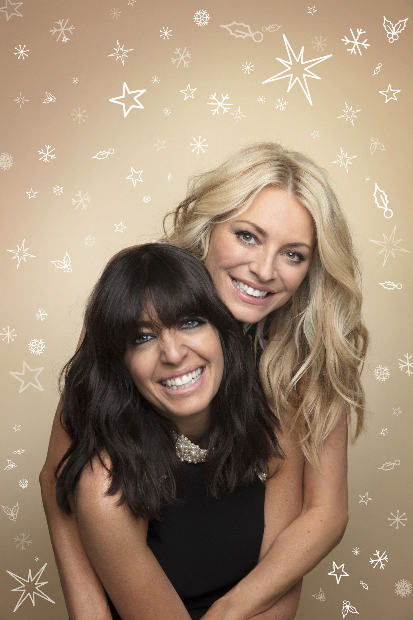 Tess Daly and Claudia Winkleman host the Strictly Come Dancing Christmas Special (Matt Holyoak/BBC)