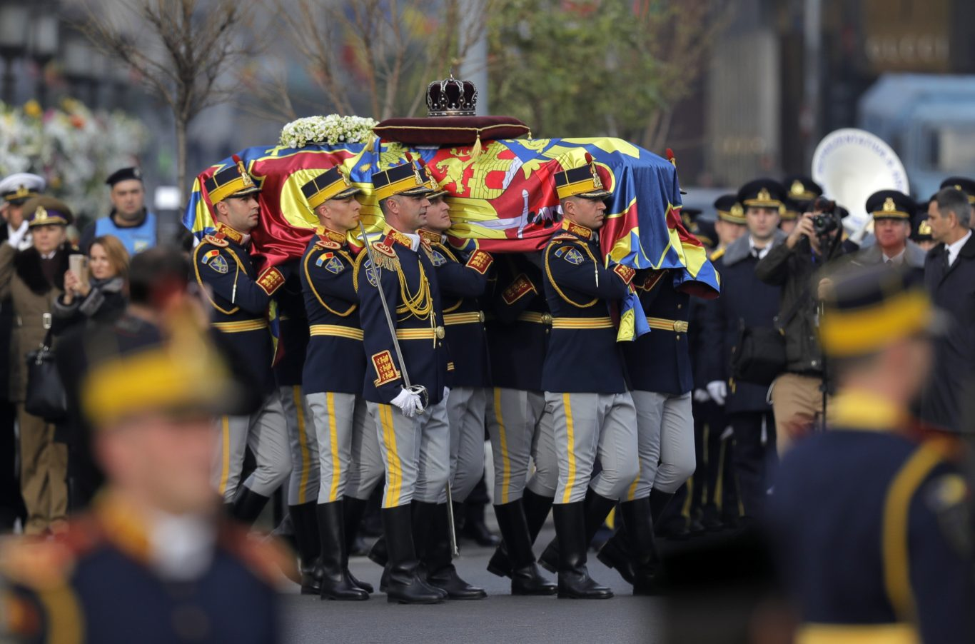 Honour guard soldiers carry the coffin of the late Romanian King Michael (Vadim Ghirda/AP)