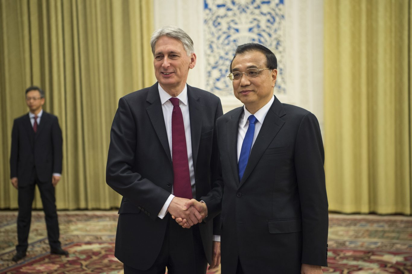 China's Premier Li Keqiang with Chancellor Philip Hammond (Fred Dufour/AP)