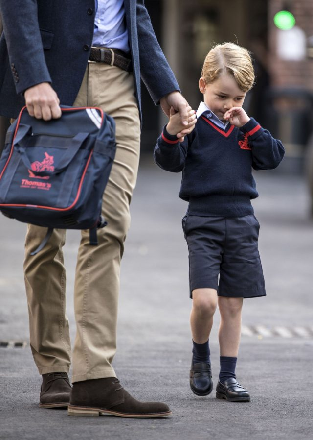 Prince George arrives with the Duke of Cambridge at Thomas's Battersea in London, as he starts his first day of school (Richard Pohle/The Times/PA)