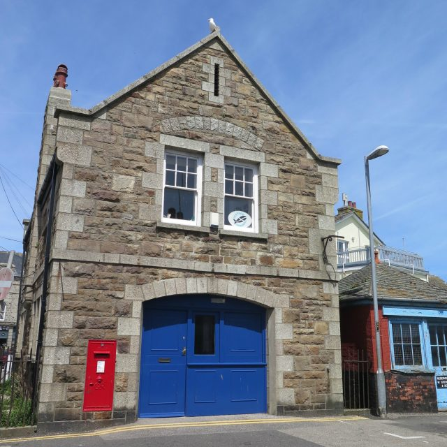 The former Admiralty Boat House in Newlyn, Cornwall (Historic England/PA)