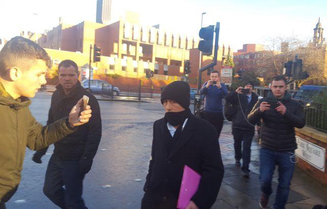 Kieran Creavan (centre) is filmed by a member of the Predator Exposure group (left) outside Leeds Crown Court (Dave Higgens/PA)