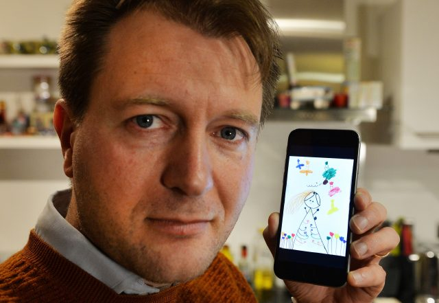 Richard Ratcliffe holds his phone with a drawing by their daughter Gabriella (John Stillwell/PA)