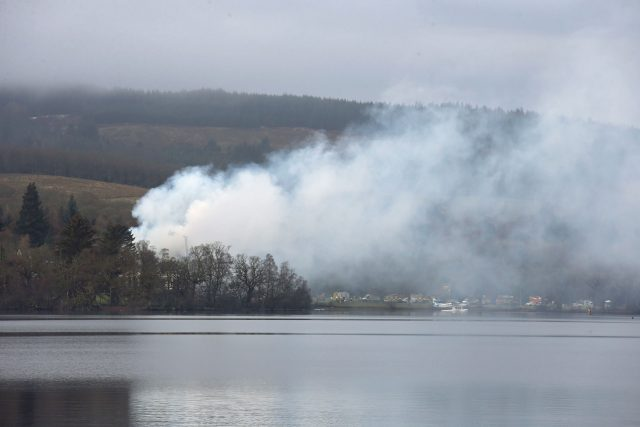 Smoke could be seen across the lake (Andrew Milligan/PA)