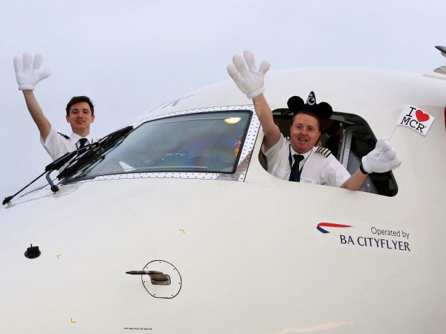 Pilot Bruce Cleghorne and co-pilot Ralph Turan pose for a photograph (Peter Byrne/PA)