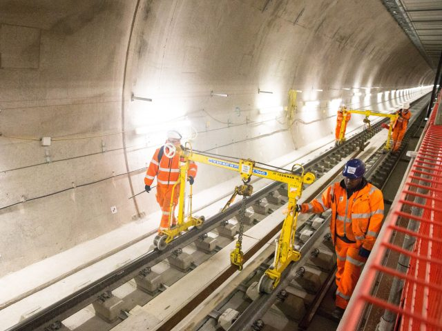 Engineers working on the track at Farringdon station as TfL marks one year until the Elizabeth line is launched (Transport for London/PA)