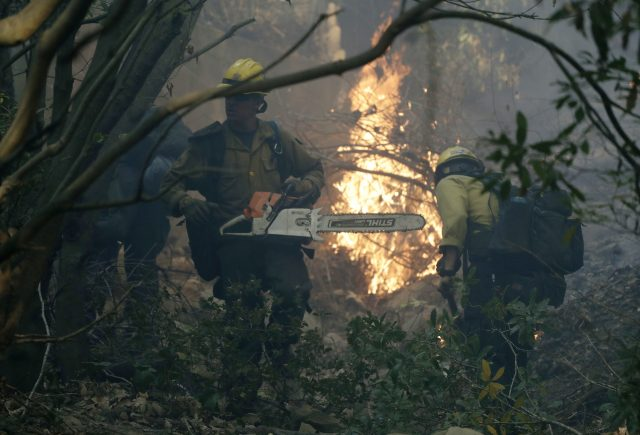 Firefighters from Kern County work to put out hot spots in Montecito