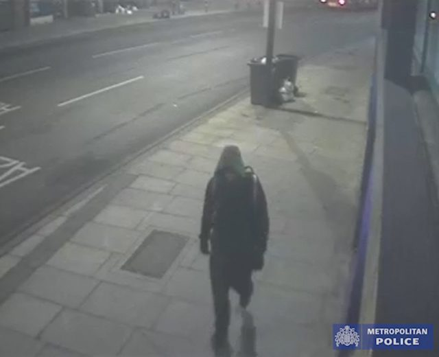 The man was wearing a hoody as he walked down Deptford Broadway carrying a large rucksack (Met Police/PA)