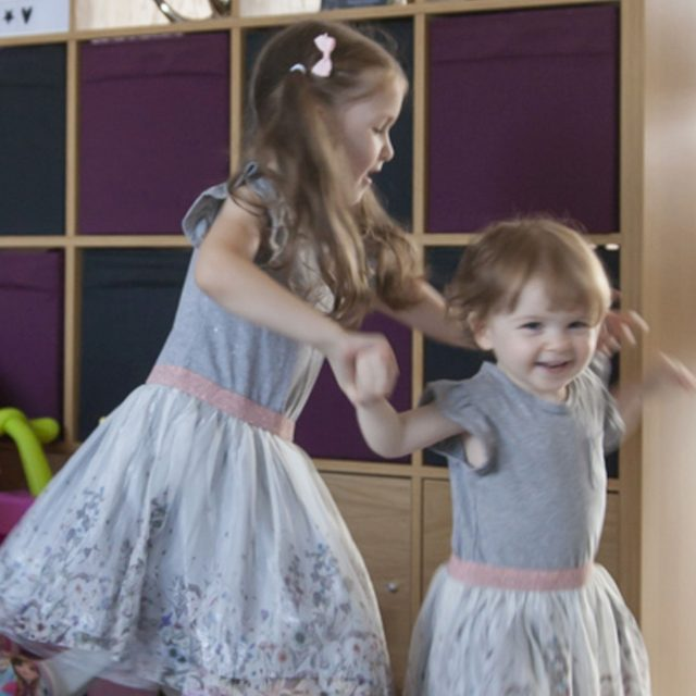 Amy (left) shows off her dance skills with sister Mia
