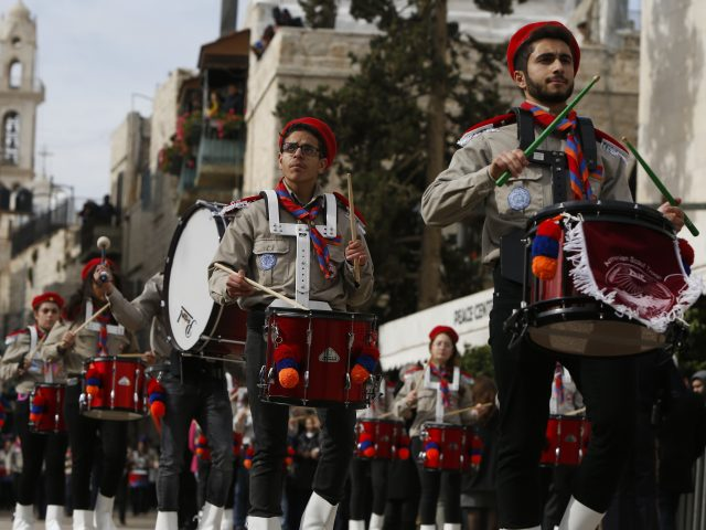 Members of a Palestinian marching band parade outside the Church of the Nativity