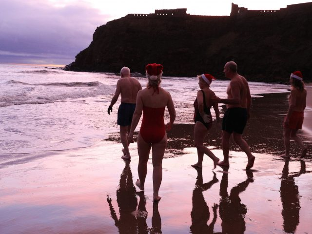 Swimmers take the plunge at King Edward's Bay, Newcastle