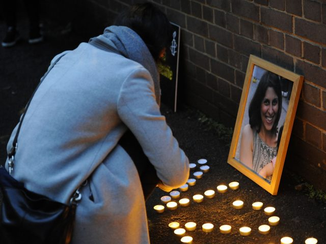 A woman lights candles at a vigil held for Nazanin Zaghari-Ratcliffe (Kirsty O'Connor/PA)