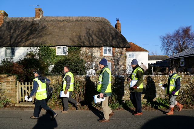Sussex Police Search Volunteers head out to deliver information leaflets in the village of Bosham in 2014 (Gareth Fuller/PA)