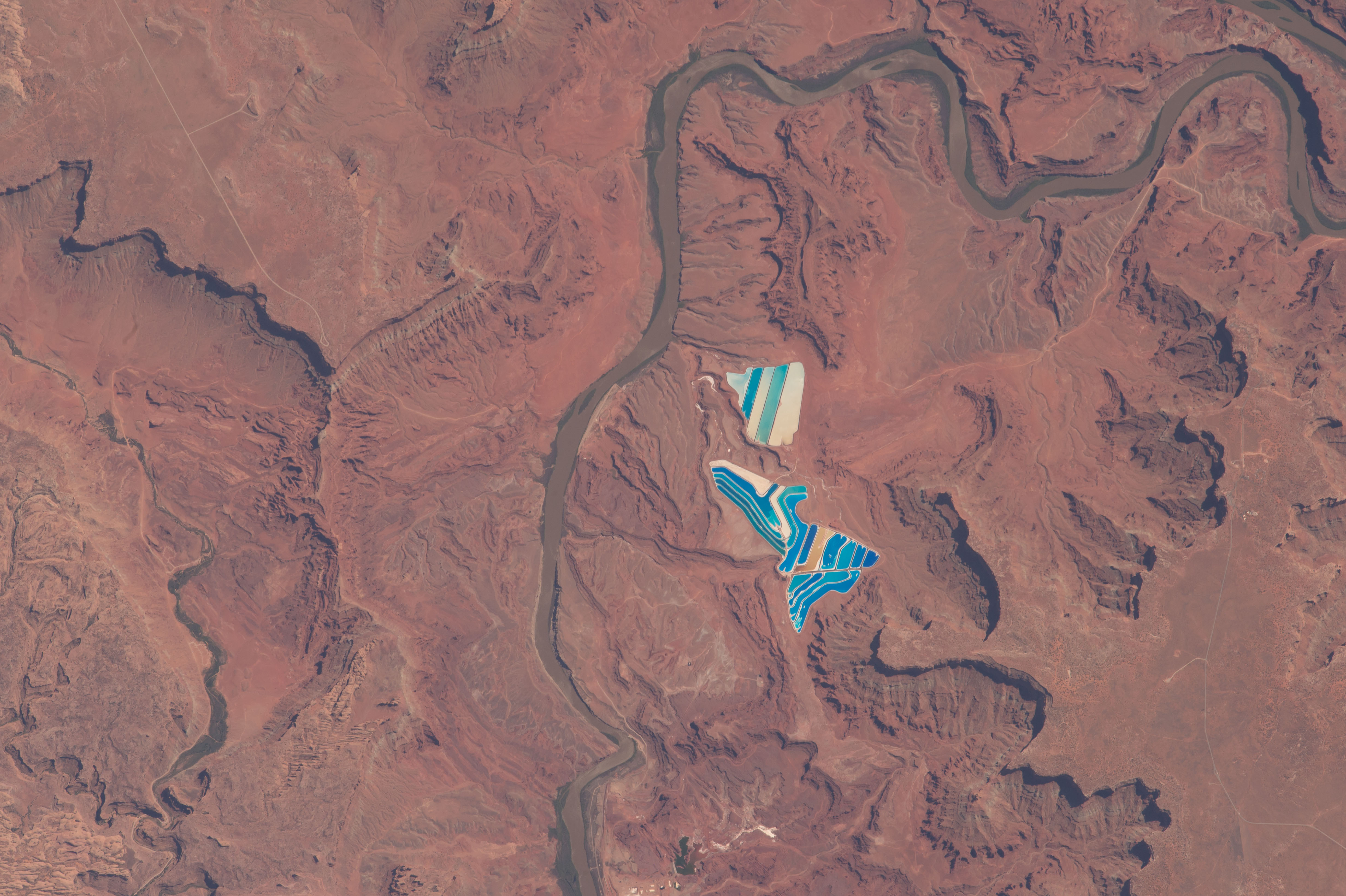 Solar evaporation ponds outside the city of Moab, Utah. There are 23 colourful ponds spread across 400 acres. They are part of a large operation to mine potassium chloride (Nasa)