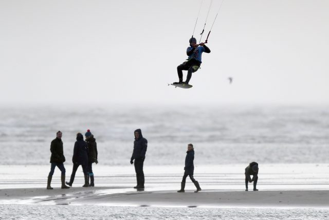 A kite surfer enjoys the windy conditions