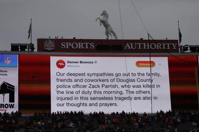 A sign expresses condolences for <a href=