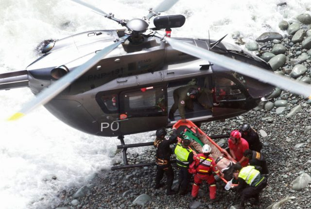 Peru bus plunges off cliff killing dozens