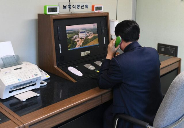 A South Korean government official checks the direct communications hotline to talk with the North Korean side at the border village of Panmunjom in Paju, South Korea (Yonhap via AP)