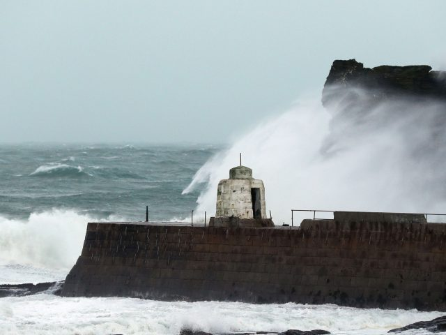 Waves crash against the cliffs in Portreath