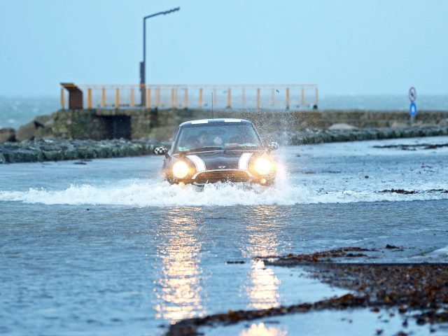 A car drives through a flooded car park in Salthill, Galway