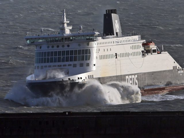 The DFDS Dover Seaways ferry crashes through waves at The Port of Dover