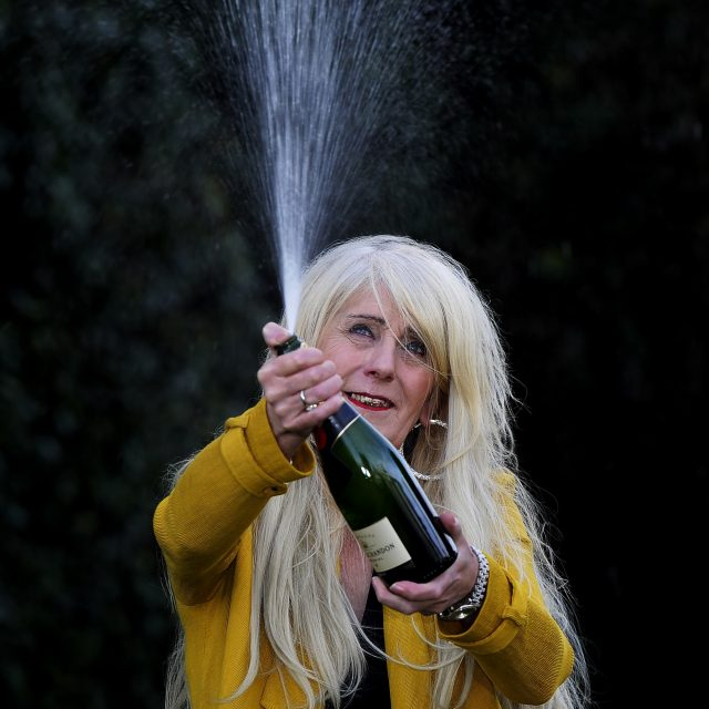 Taxi driver Melissa Ede celebrates the win