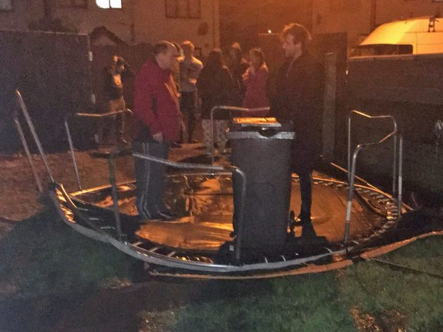 People hold down a trampoline in Carrickfergus, Northern Ireland