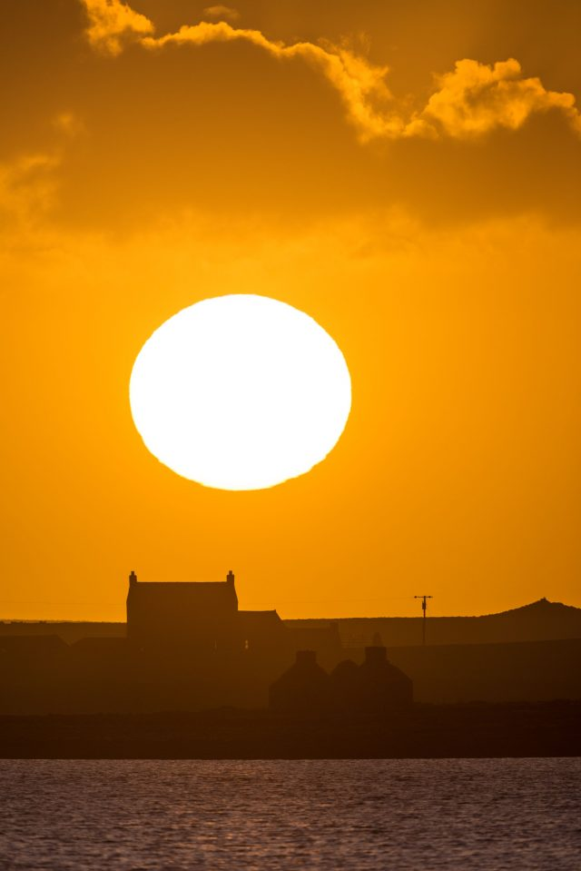 The sun setting over the Scottish island of Stronsay (Raymond Besant/PA)