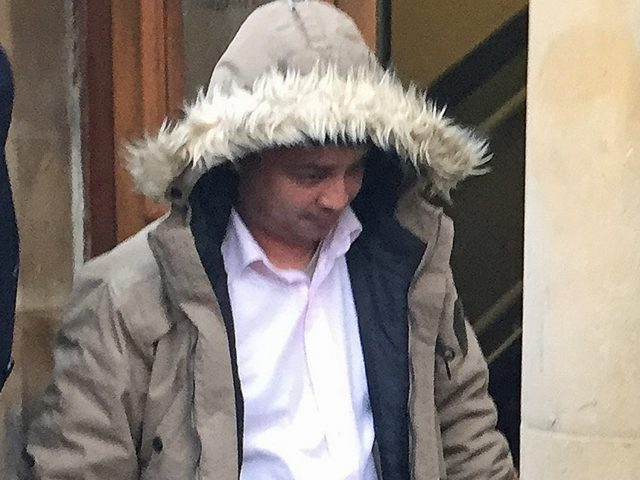 Harun Rashid leaving Blackburn Magistrates' Court  (Eleanor Barlow/PA)