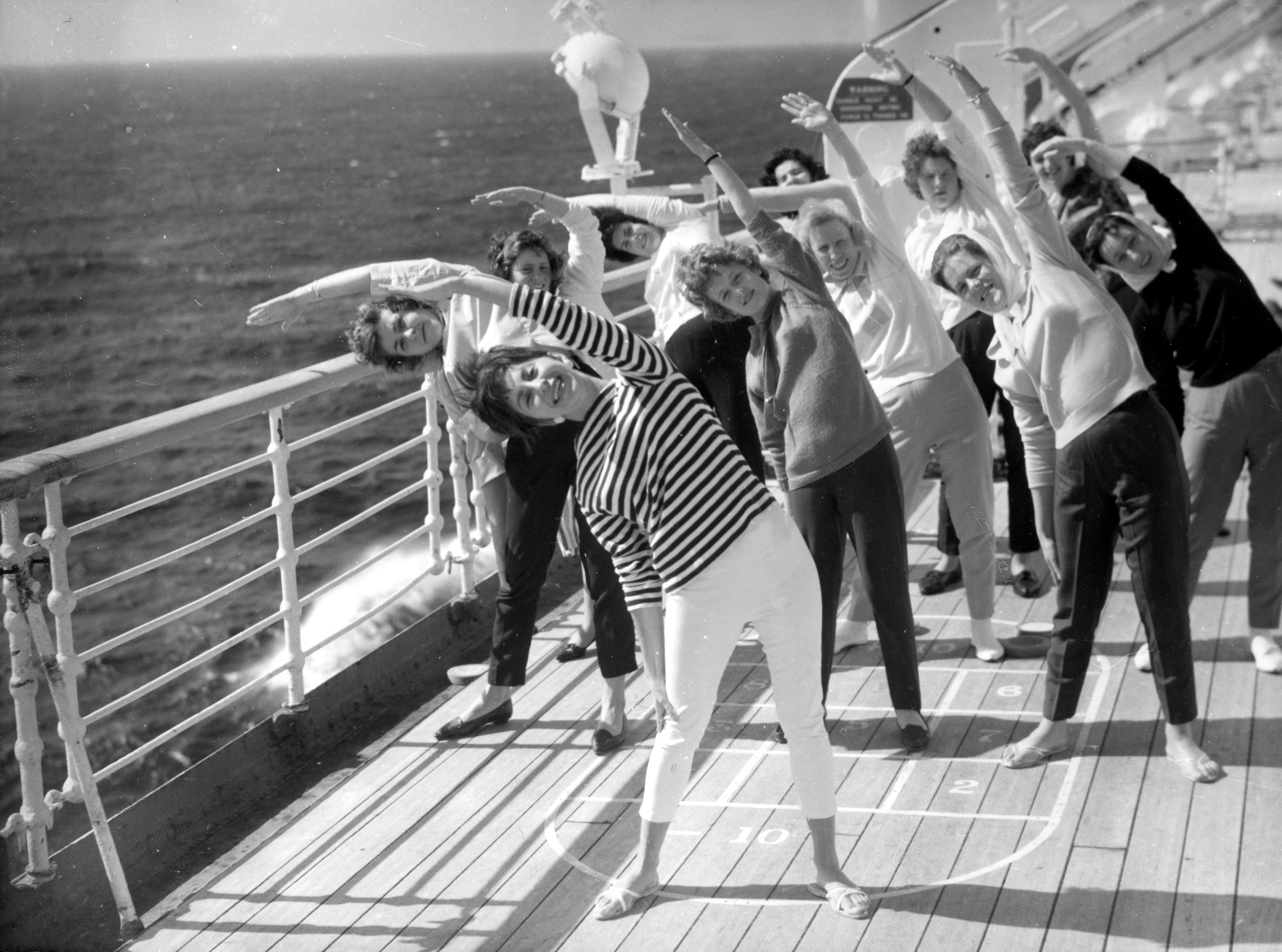 Dancer Lesley Ross from Sussex leads an exercise session on the deck of the Cunarder Sylvania in the mid-Atlantic. (PA)