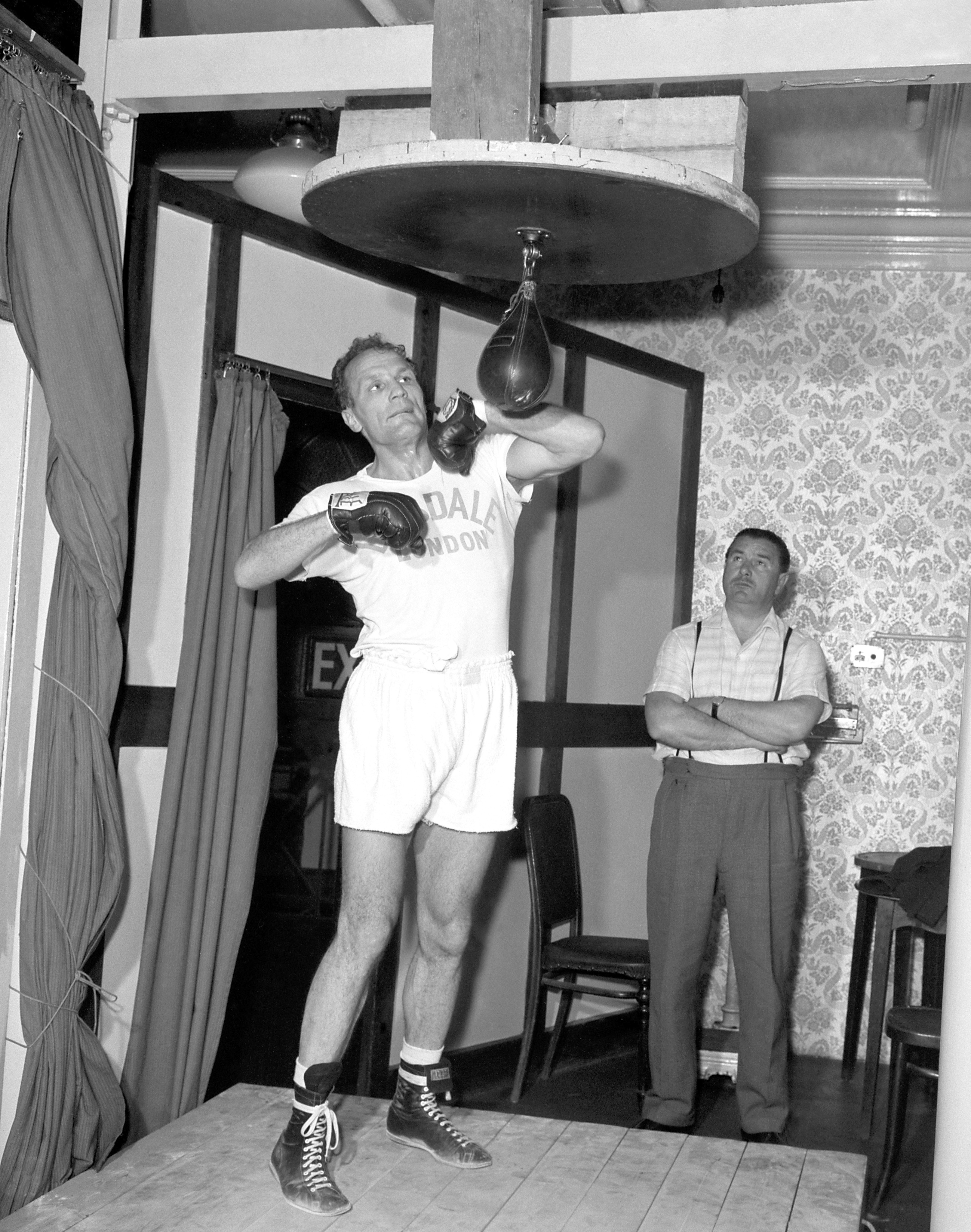British heavyweight champion Henry Cooper during training at Bellingham in Kent, where he is preparing for an encounter at Wembley with American boxer Cassius Clay.(PA)