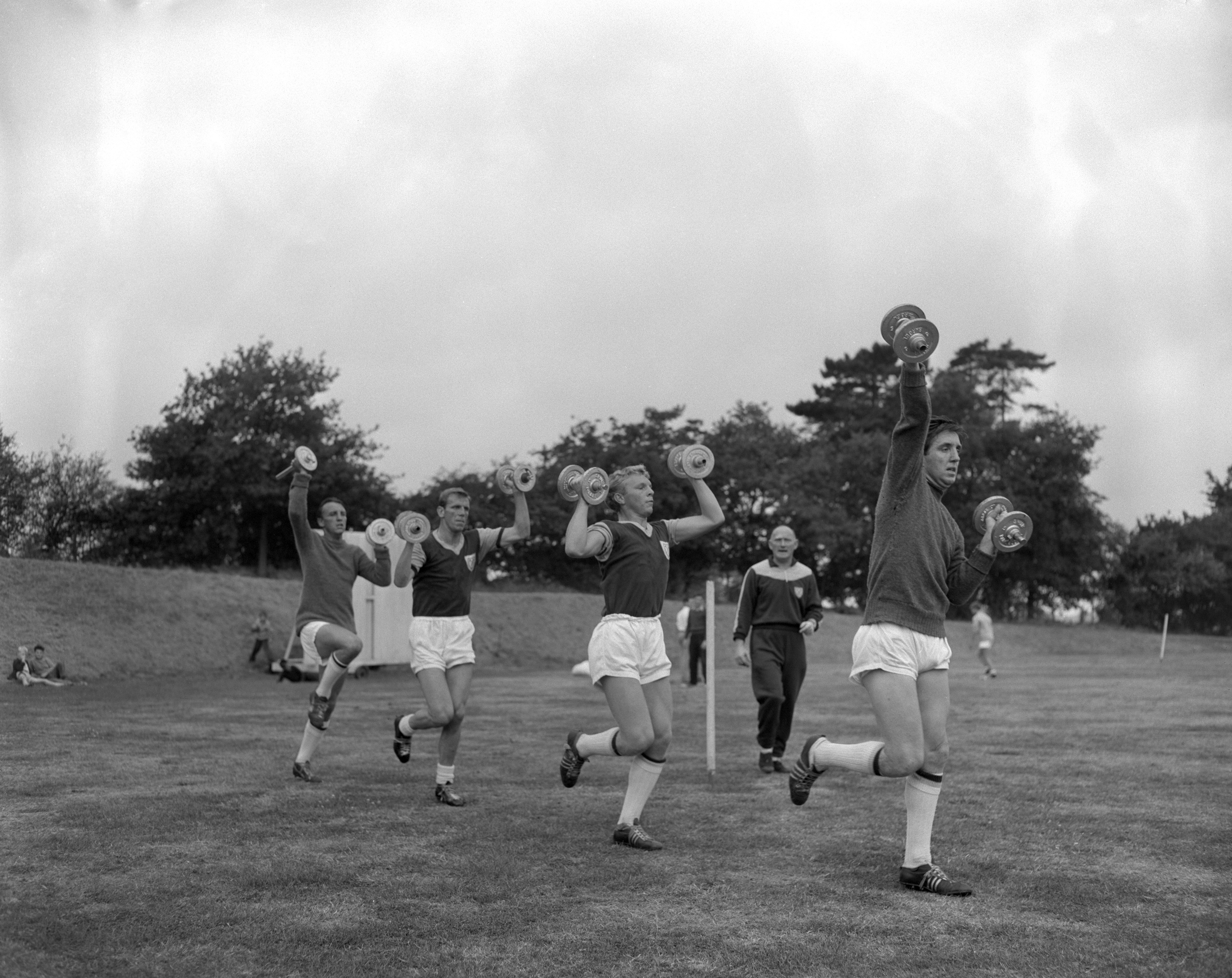 West Ham players, including Bobby Moore (centre), in training in 1959 (PA)