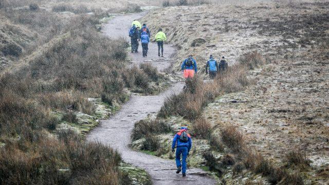 Walkers ascent Pen Y Fan, the highest peak in South Wales (Ben Birchall/PA)