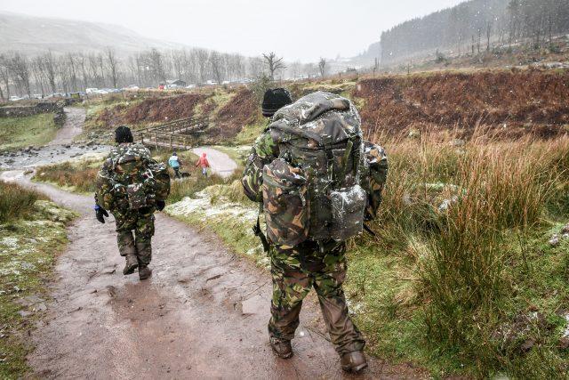 Some of those braving Pen y Fan were attempting the Fan Dance, a 24km SAS Selection test march (Ben Birchall/PA)