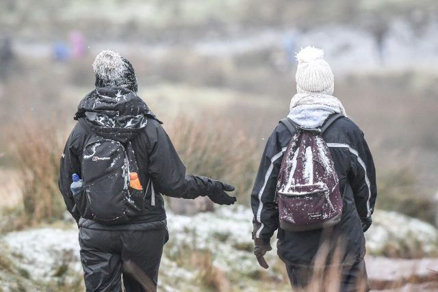 More casual walkers were also seen carrying snow-covered rucksacks (Ben Birchall/PA)