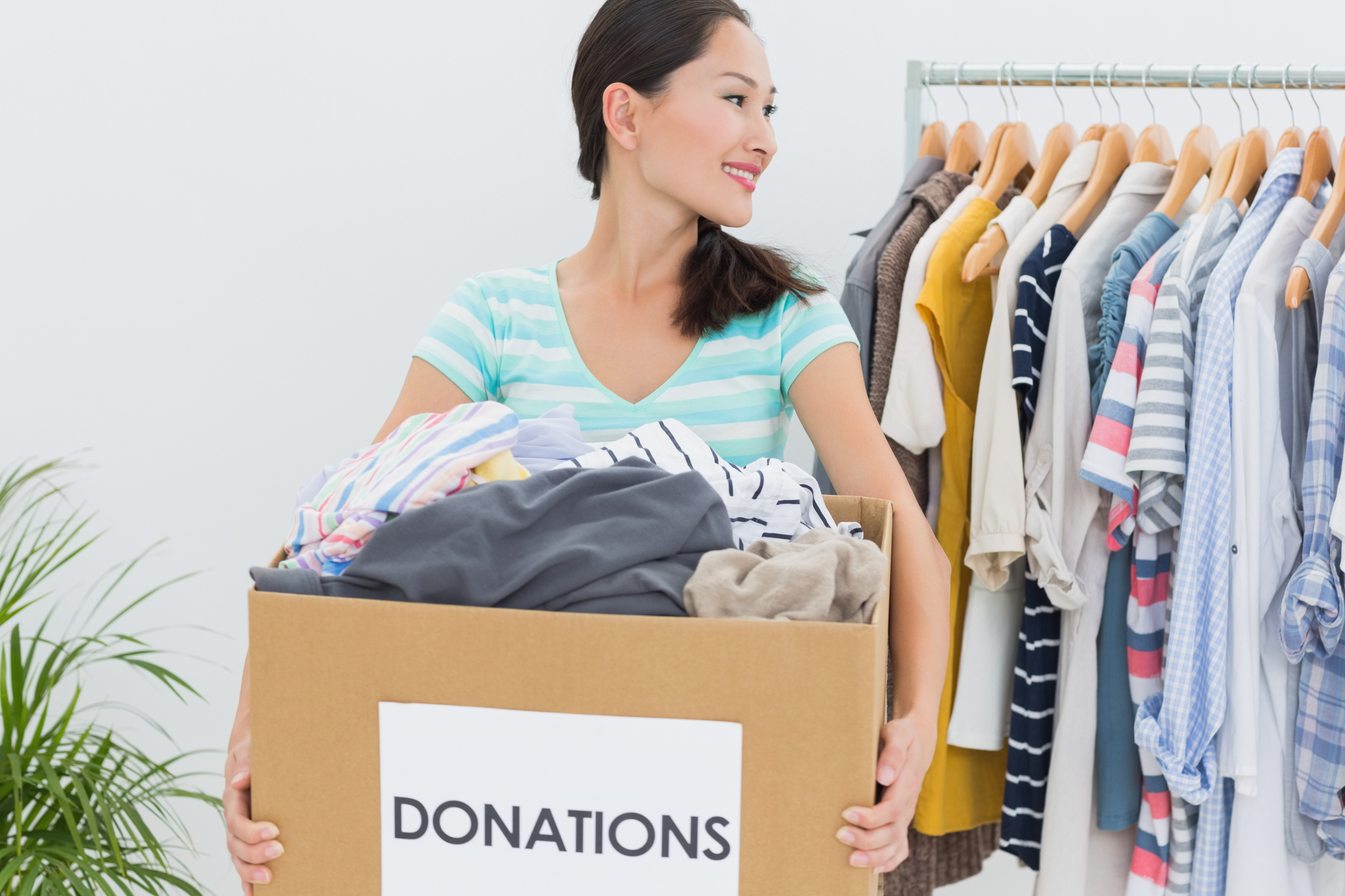 Generic photo of woman sorting clothes to give to charity (Thinkstock/PA)