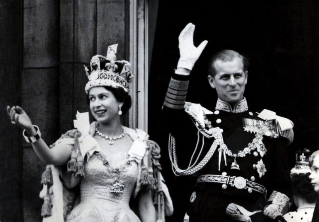 The Queen and the Duke of Edinburgh waving from the balcony of Buckingham Palace after the coronation