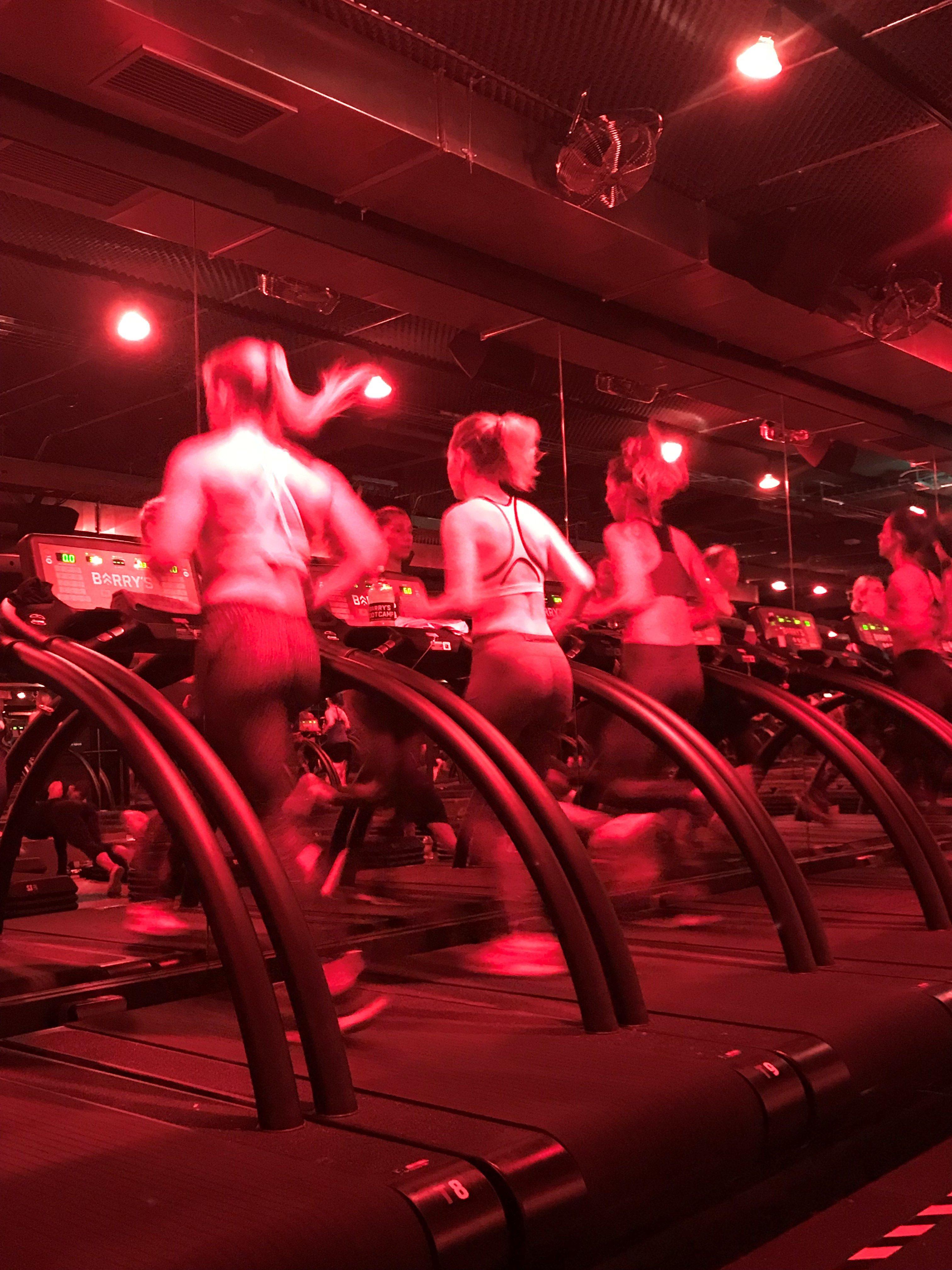 women running on treadmills