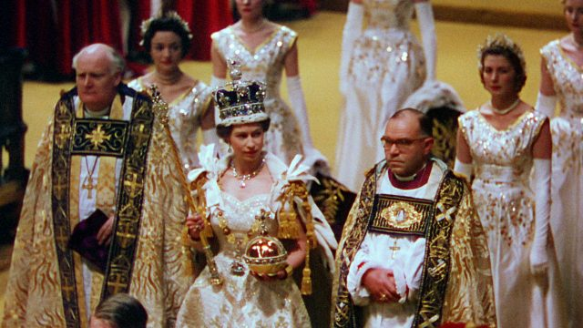 The Queen with her Maids of Honour and the Archbishop of Canterbury during the coronation (BBC/PA)