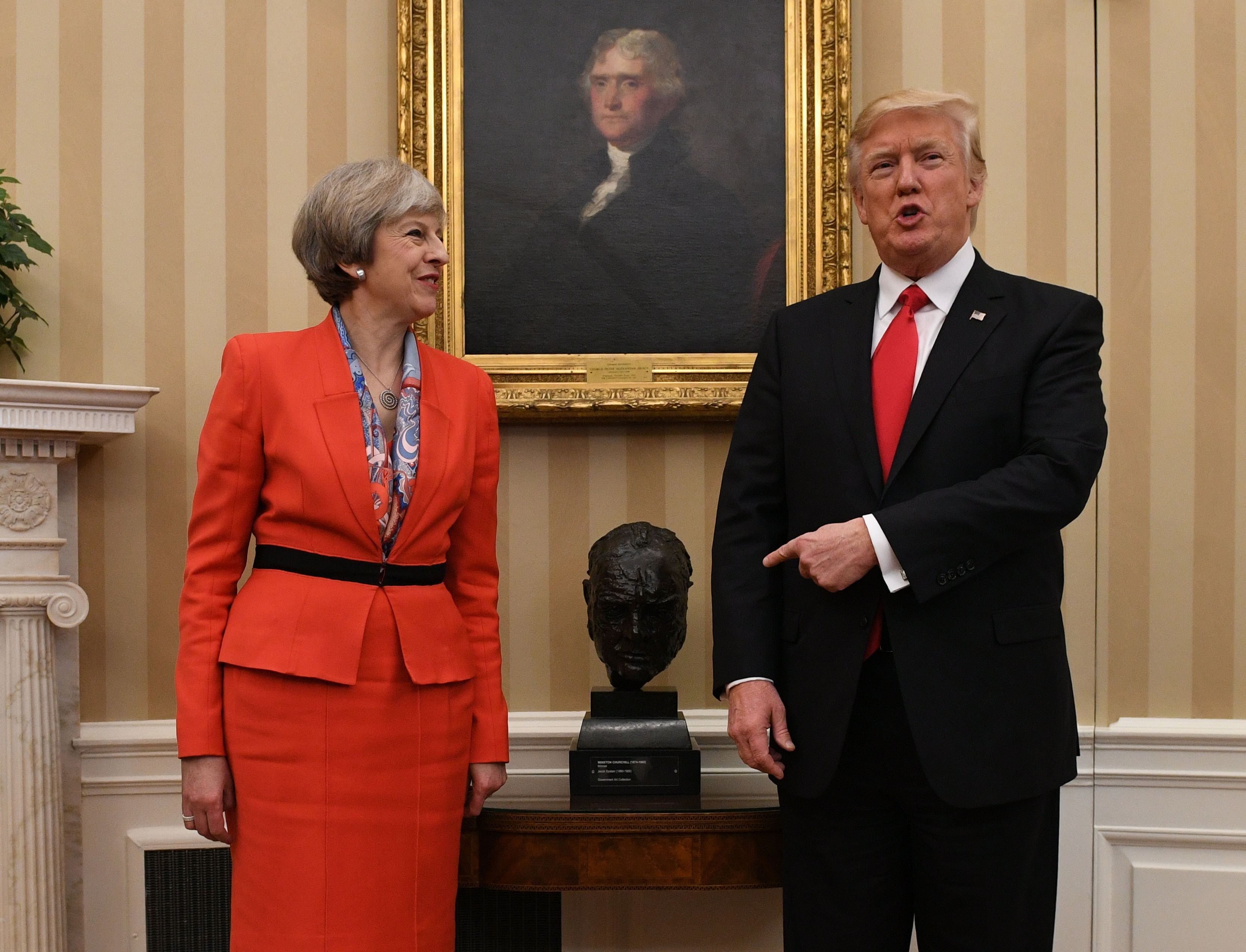 Theresa May meets Donald Trump as he points to a bust of Sir Winston Churchill