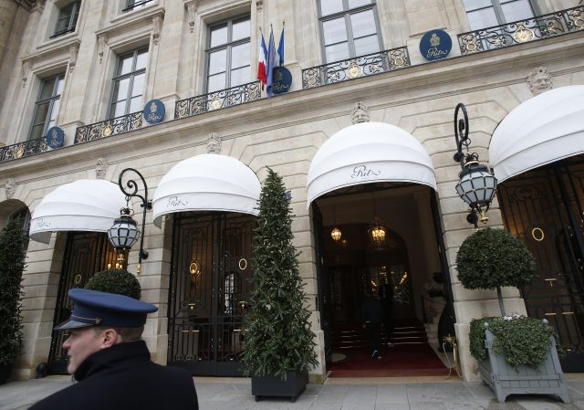 A valet waits outside the Ritz hotel in Paris (Michel Euler/AP)