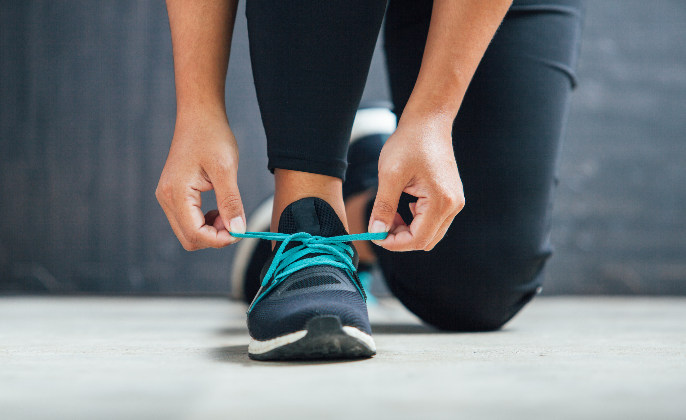 Female runner tying her shoes preparing for a run (Thinkstock/PA)